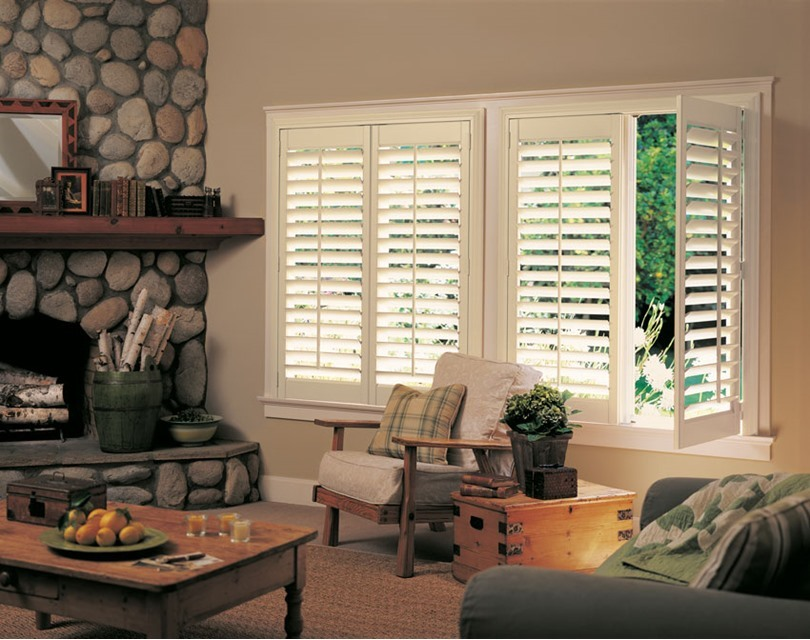 Timber shutters and stone fireplace