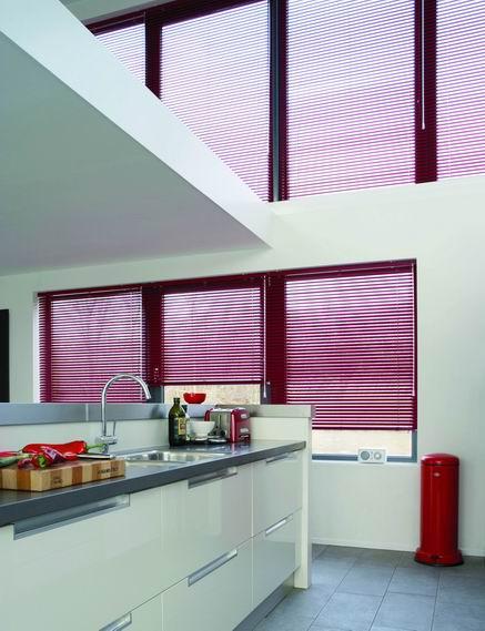 Coloured aluminium Venetian blinds in a kitchen
