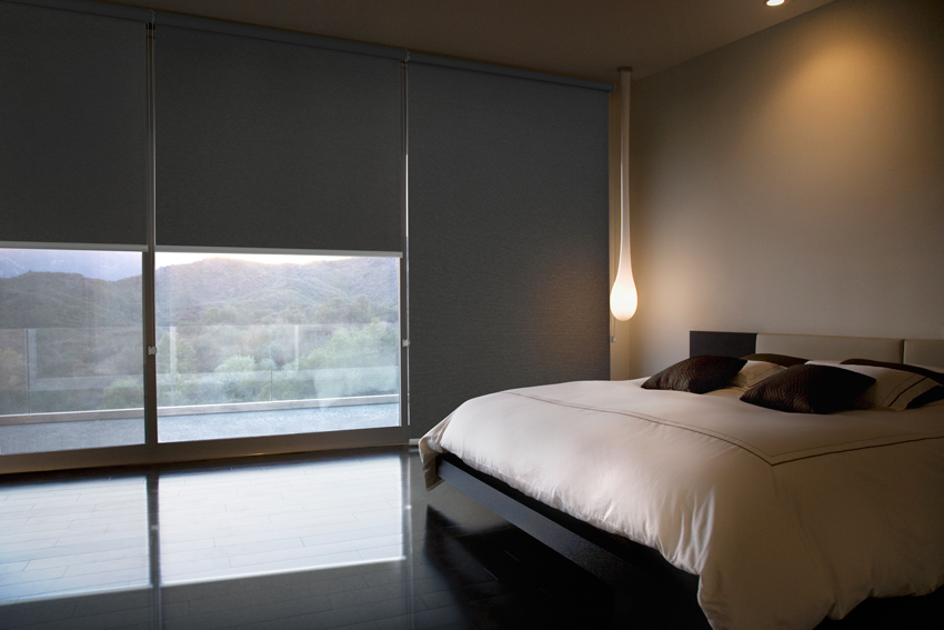 Blockout roller blinds in bedroom