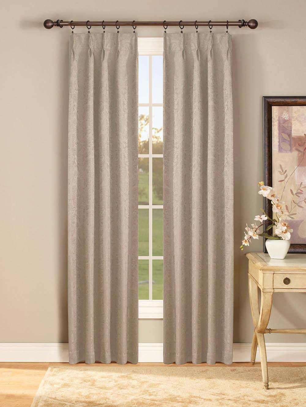 Triple pinch pleated curtains with curtain rod
