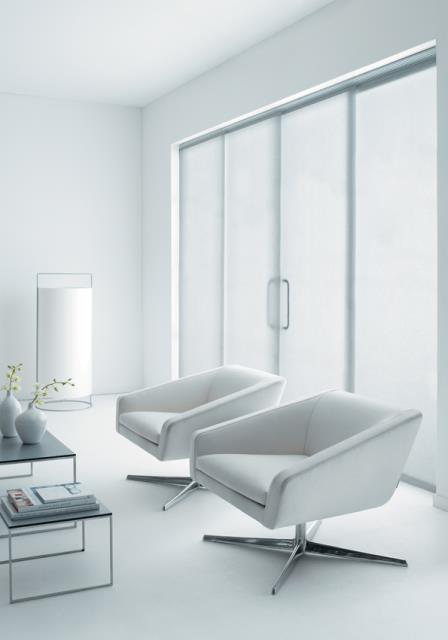 White living area with white glide panel blinds