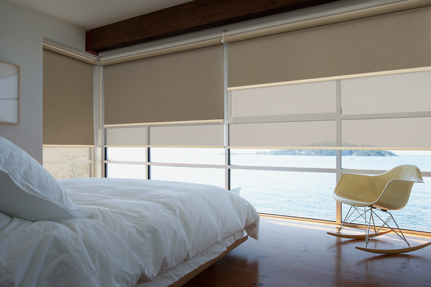 Roller blinds in a bedroom