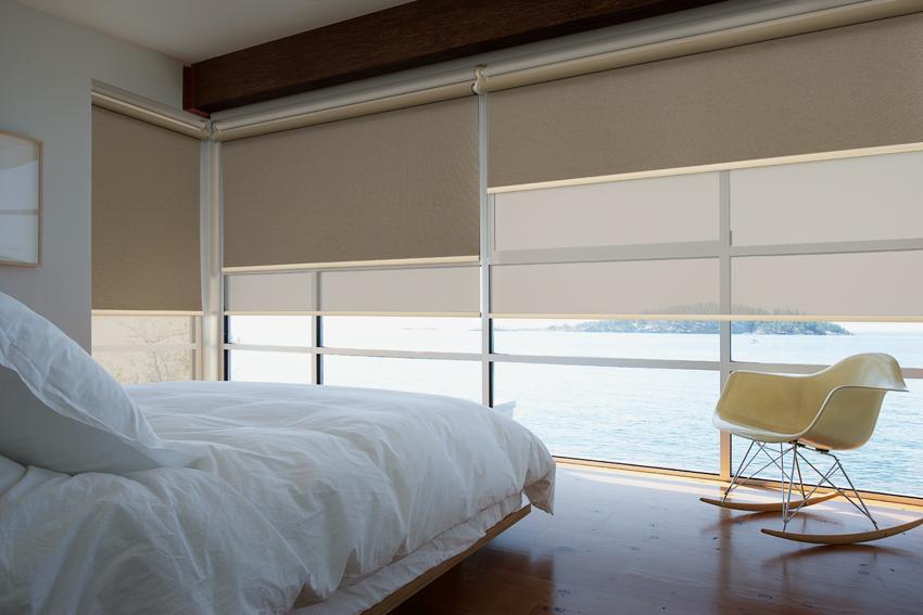 Roller blinds in a bedroom