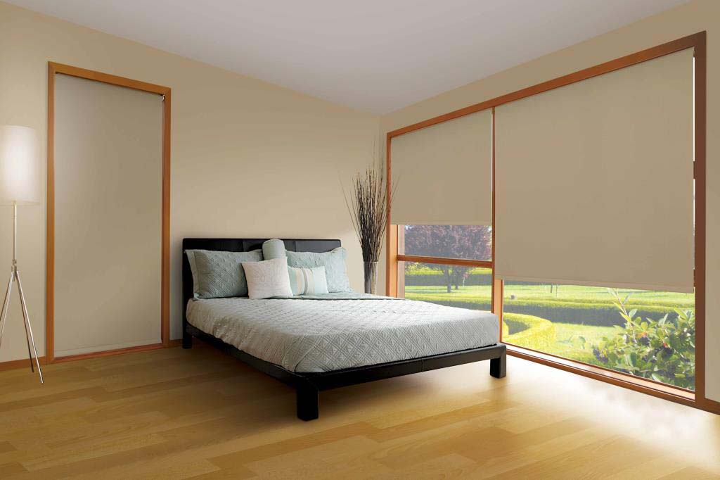 Blockout roller blinds in a bedroom