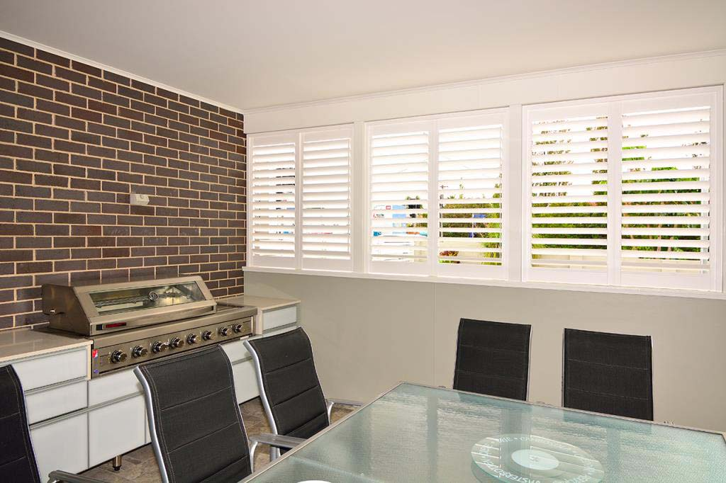 Polysatin shutters outdoor barbeque area