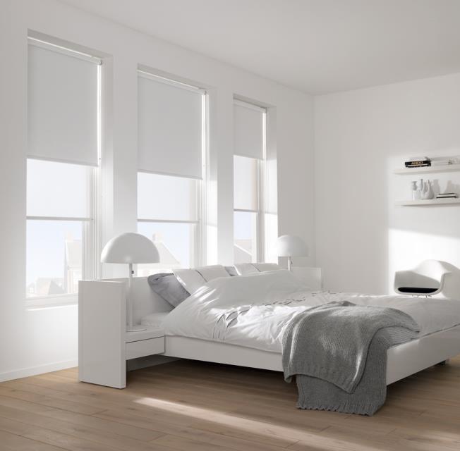 Roller blinds in a white bedroom