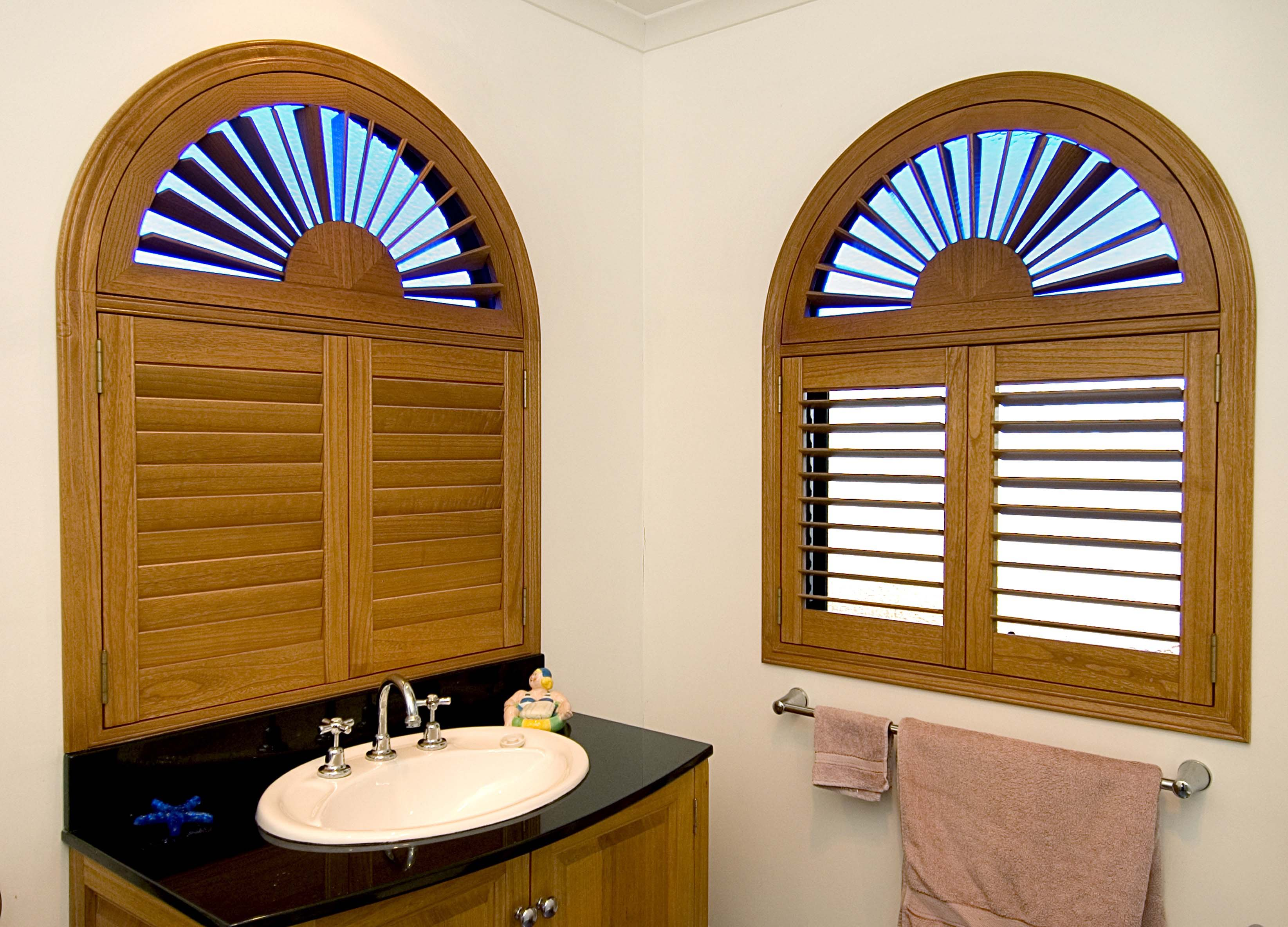 Shaped timber shutters in bathroom