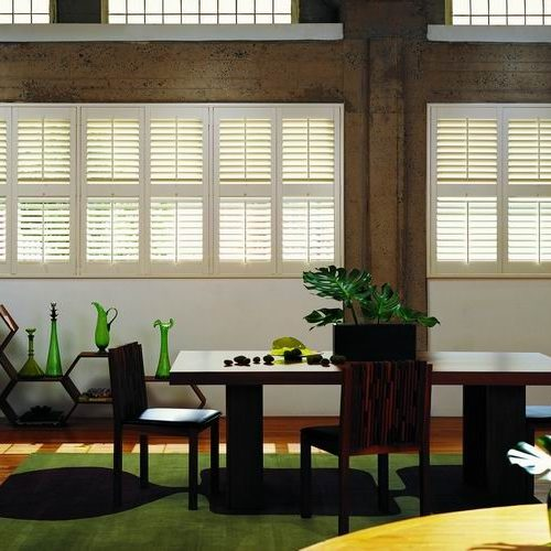 Timber shutters with green and black accessories