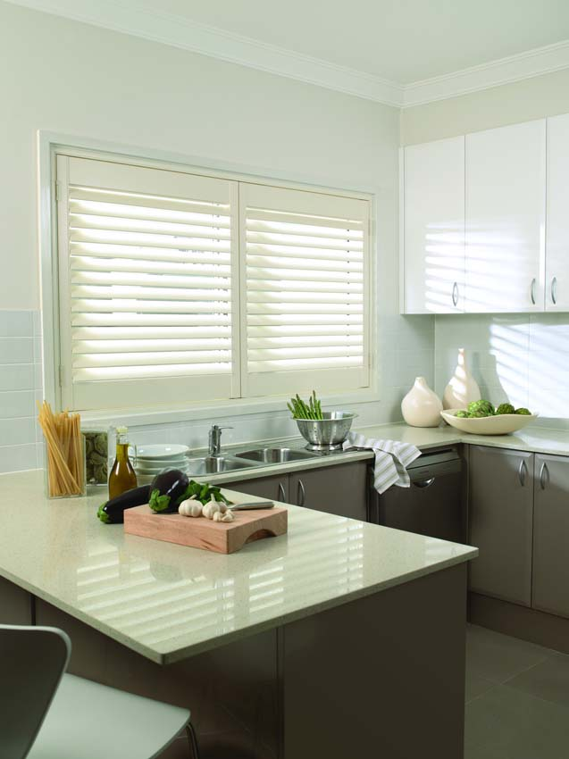 Timber shutters in a kitchen