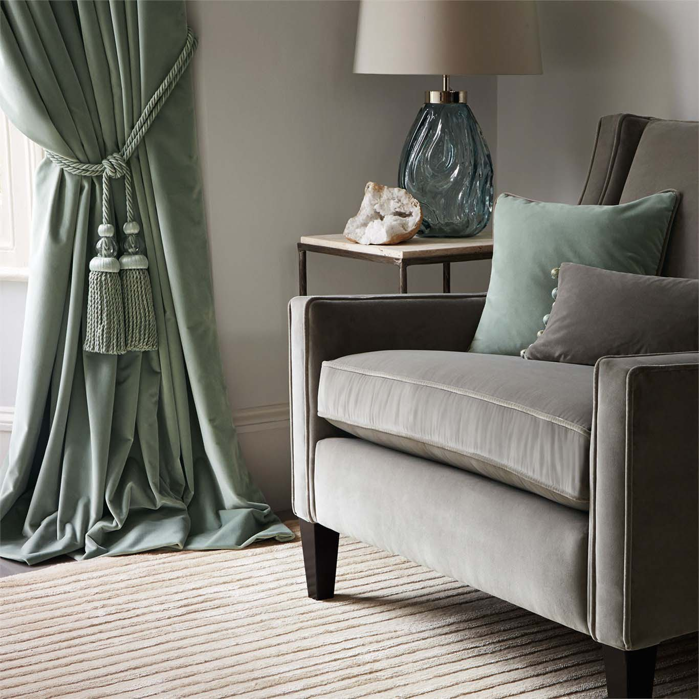 Chair and cushions with curtains and accessories in lounge area