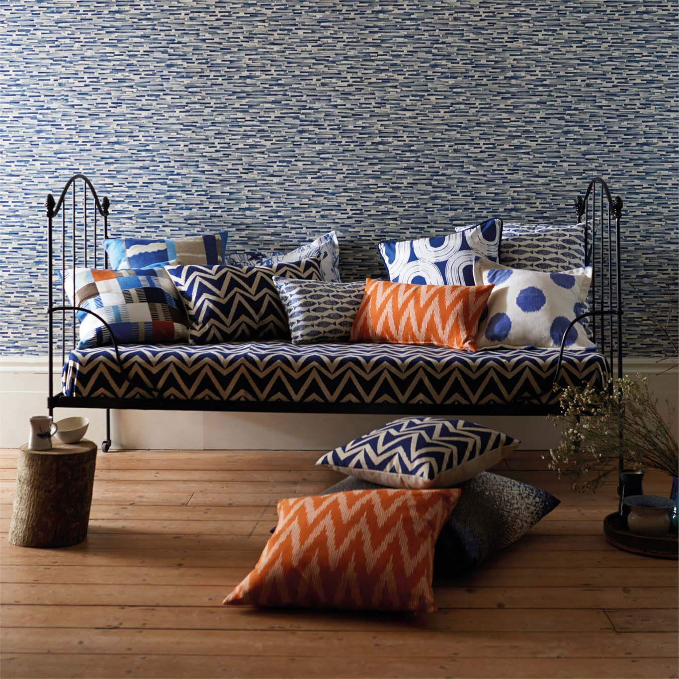 Lounge with cushions and wallpaper