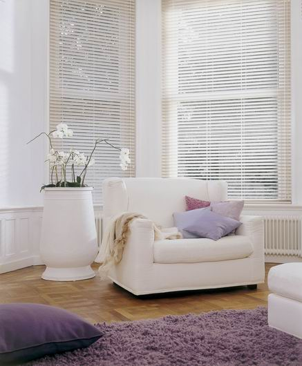 Venetian Country Woods blinds in lounge area with purple accessories