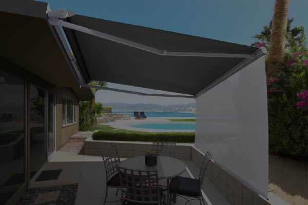 An outdoor dining set covered with a foldable awning.