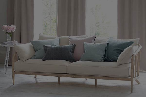 A pelmets valances curtain behind a wooden couch