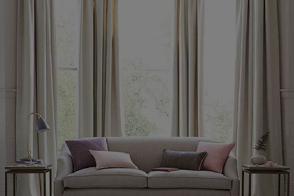 a rods tracks curtain covering tall windows
