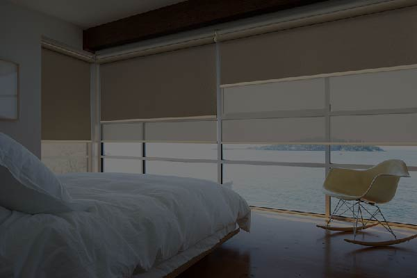 Roller blinds on a bedroom window