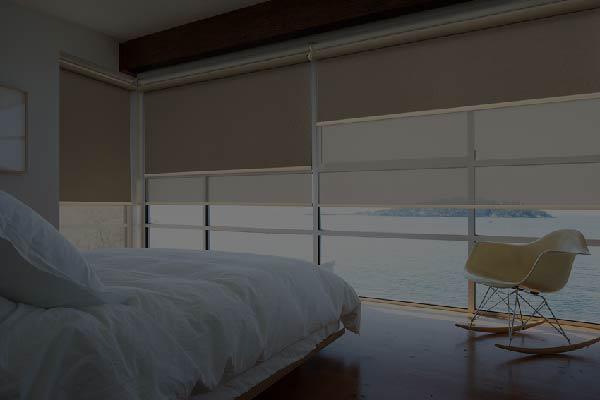 Roller blinds on a bedroom window