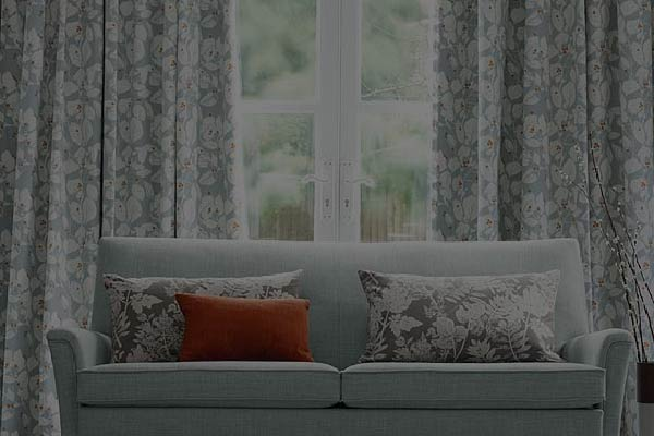 A floral patterned S-fold curtains